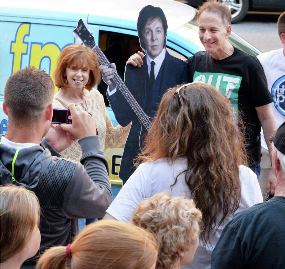 Fans takes turns being photographed with a Paul McCartney cut-out at the Times Union Center before the Paul McCartney Out There tour concert Saturday July 5, 2014, in Albany, NY.  (John Carl D'Annibale / Times Union) Photo: John Carl D'Annibale / 00027433A