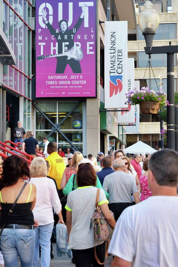 Fans arrive at the Times Union Center before the Paul McCartney Out There tour concert Saturday July 5, 2014, in Albany, NY.  (John Carl D'Annibale / Times Union) Photo: John Carl D'Annibale / 00027433A