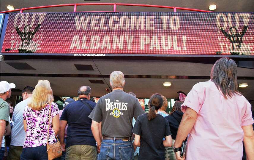Fans queue up for official tour merchandise at the Times Union Center before the Paul McCartney Out