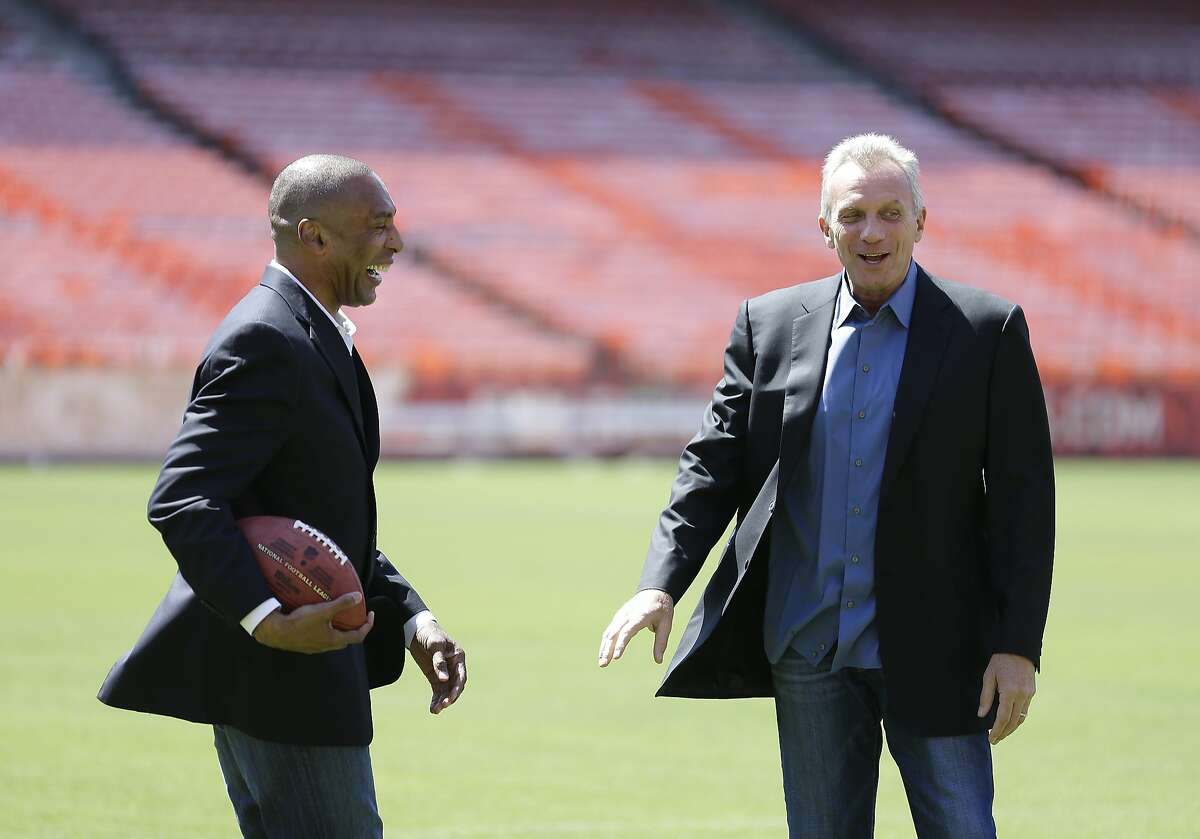 San Francisco 49ers Hall of Fame quarterback Joe Montana, right, and retired running back Roger Craig, left, laugh during a photo shoot at Candlestick Park before a news conference about their upcoming flag football game Wednesday, June 4, 2014, in San Francisco.