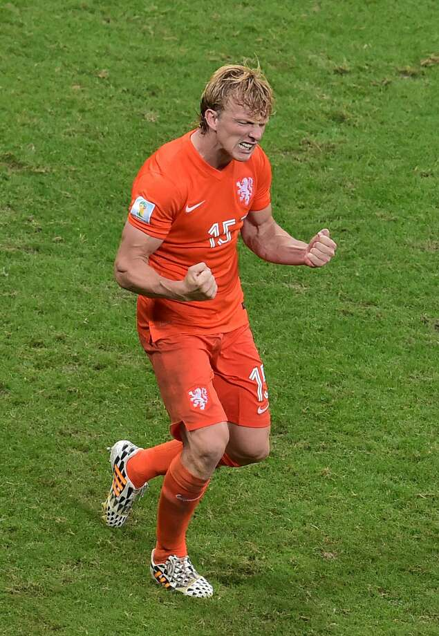 Netherlands' defender Dirk Kuyt celebrates after scoring during the penalty shout out of a quarter-final football match between Netherlands and Costa Rica at the Fonte Nova Arena in Salvador during the 2014 FIFA World Cup on July 5, 2014.       AFP PHOTO / GABRIEL BOUYSGABRIEL BOUYS/AFP/Getty Images Photo: GABRIEL BOUYS, AFP/Getty Images / AFP