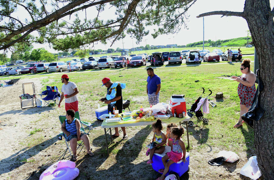 Members of the Ceballos and Ortega families from Bridgeport and Stratford, gather for fun and food as they await fireworks at Short Beach Park in Stratford, Conn. on Saturday July 5, 2014. Photo: Christian Abraham / Connecticut Post
