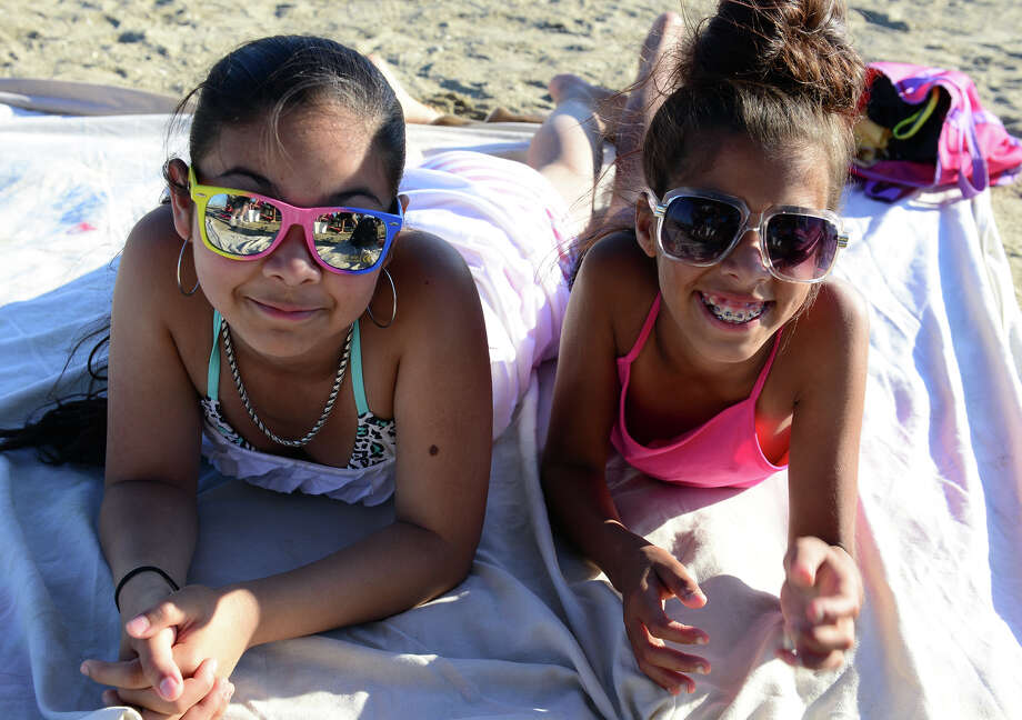 Shaneca Reboira, 12, and Tyenna Torres, 12, both of Bridgeport, have fun and food as they await fireworks at Short Beach Park in Stratford, Conn. on Saturday July 5, 2014. Photo: Christian Abraham / Connecticut Post