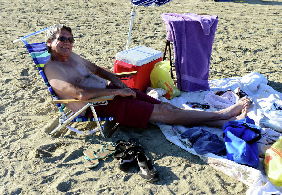 Brad Madigan, of Stratford, relaxes on the beach as he awaits fireworks at Short Beach Park in Stratford, Conn. on Saturday July 5, 2014. Photo: Christian Abraham / Connecticut Post