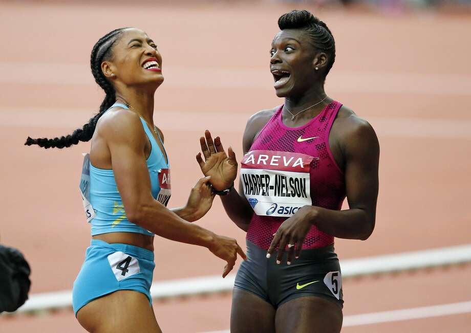 American Dawn Harper-Nelson (right) celebrates after her 100 hurdles win. Photo: Francois Mori, Associated Press
