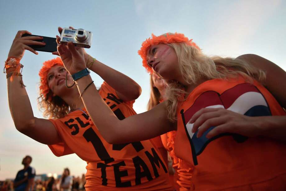 Netherlands fans react to the live projection of the quarter-final match between Netherlands and Costa Rica on Copacabana Beach in Rio de Janeiro on July 5, 2014, during the FIFA World Cup 2014 in Brazil.  AFP PHOTO / YASUYOSHI CHIBAYASUYOSHI CHIBA/AFP/Getty Images Photo: YASUYOSHI CHIBA, AFP/Getty Images / AFP