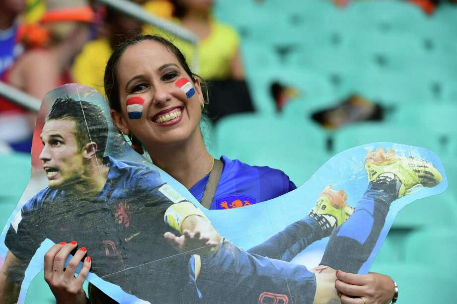 TOPSHOTS  A Netherlands' fan holds a cut-out of Netherlands' forward and captain Robin van Persie as she awaits the kick-off of the quarter-final football match between Netherlands and Costa Rica at the Fonte Nova Arena in Salvador during the 2014 FIFA World Cup on July 5, 2014. AFP PHOTO / RONALDO SCHEMIDTRONALDO SCHEMIDT/AFP/Getty Images Photo: RONALDO SCHEMIDT, AFP/Getty Images / AFP