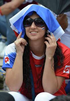 Costa Rican fan awaits for the start of the broadcasting of the Brazil 2014 FIFA World Cup Netherlands vs Costa Rica match in San Jose on July 5, 2014 .    AFP PHOTO/Ezequiel BECERRAEZEQUIEL BECERRA/AFP/Getty Images Photo: EZEQUIEL BECERRA, AFP/Getty Images / AFP