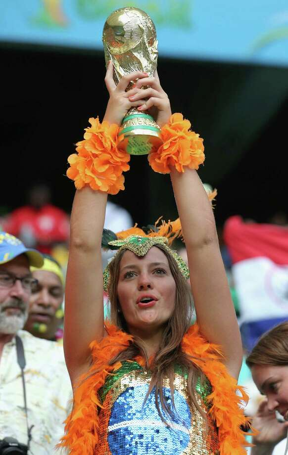 SALVADOR, BRAZIL - JULY 05:  A Netherlands fan holds a replica of the World Cup trophy prior to the 2014 FIFA World Cup Brazil Quarter Final match between the Netherlands and Costa Rica at Arena Fonte Nova on July 5, 2014 in Salvador, Brazil. Photo: Dean Mouhtaropoulos, Getty Images / 2014 Getty Images