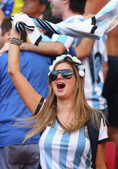 BRASILIA, BRAZIL - JULY 05:  An Argentina fan cheers during the 2014 FIFA World Cup Brazil Quarter Final match between Argentina and Belgium at Estadio Nacional on July 5, 2014 in Brasilia, Brazil. Photo: Julian Finney, Getty Images / 2014 Getty Images