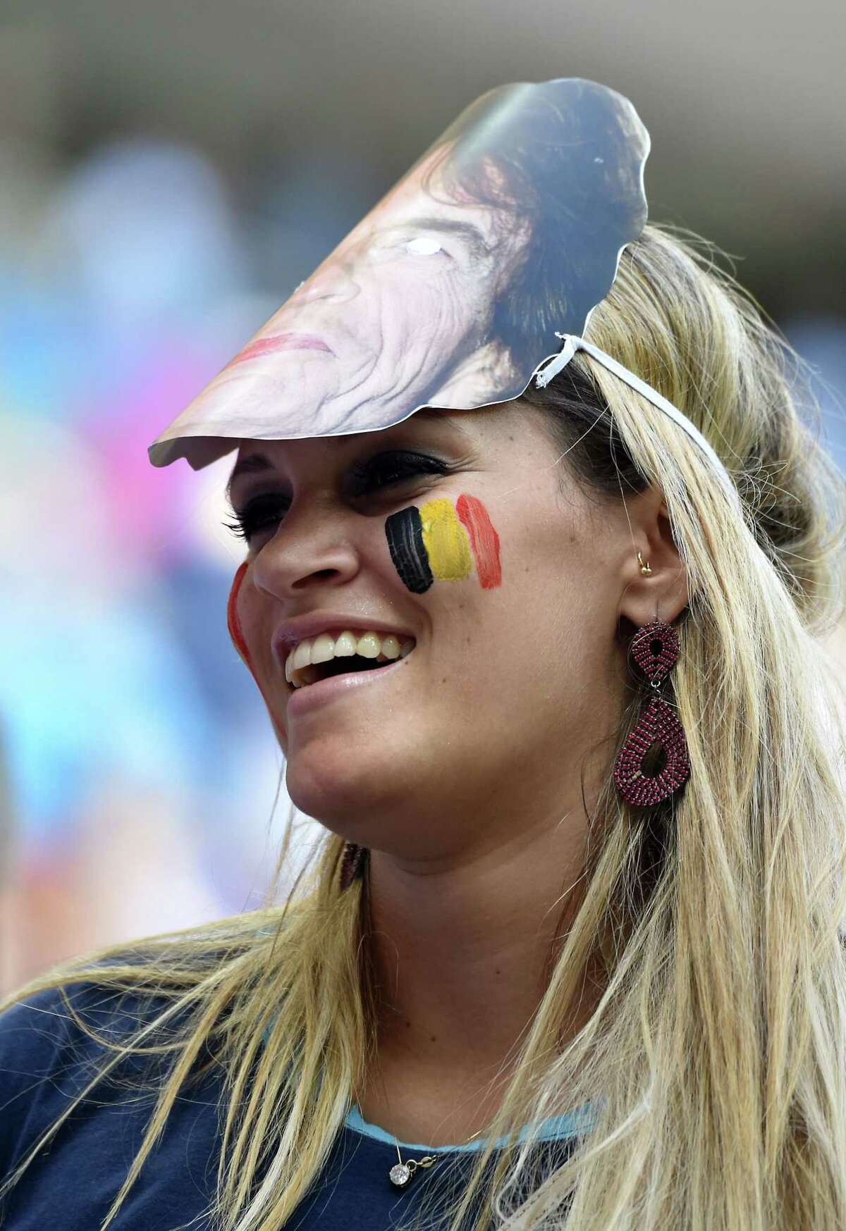 A fan of Belgium smiles prior to a quarter-final football match between Argentina and Belgium at the Mane Garrincha National Stadium in Brasilia during the 2014 FIFA World Cup on July 5, 2014. AFP PHOTO / FRANCOIS XAVIER MARITFRANCOIS XAVIER MARIT/AFP/Getty Images