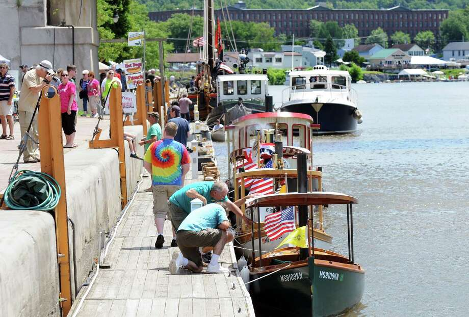 Festival goers look over the unique boats during the annual Steamboat Fest on Saturday, July 5, 2014, at the Waterford Harbor Visitors Center in Waterford, N.Y. (Cindy Schultz / Times Union) Photo: Cindy Schultz