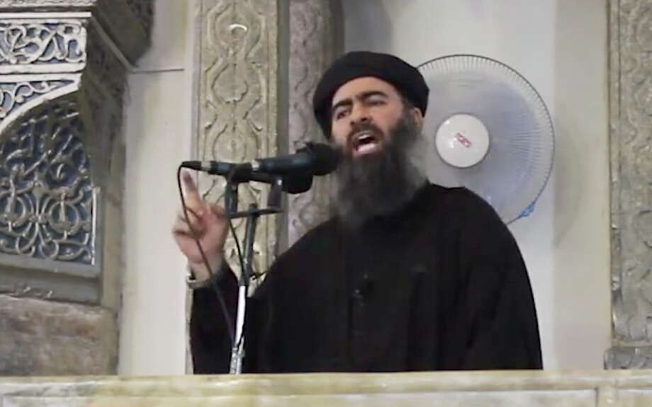 Abu Bakr al-Baghdadi, leader of the Islamic State of Iraq and the Levant, urged jihad during his sermon in Mosul, Iraq. Photo: Associated Press / Militant video