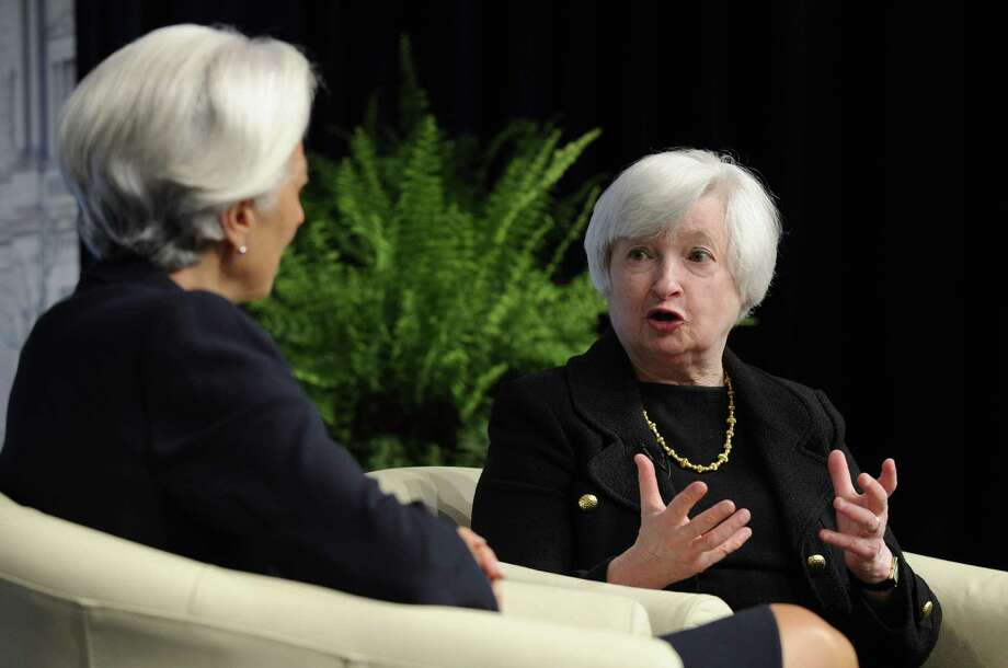 Janet Yellen (right), who succeeded Ben Bernanke as Fed chair, has continued an emphasis on low interest rates. Photo: Susan Walsh / Associated Press / AP