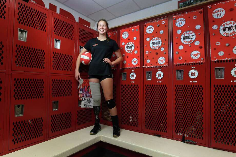 Abby Mueller, shown in the Memorial girls volleyball locker room, helped the Mustangs to a 32-9 record and third straight playoff appearance last season. Photo: Karen Warren, Staff / © 2013 Houston Chronicle