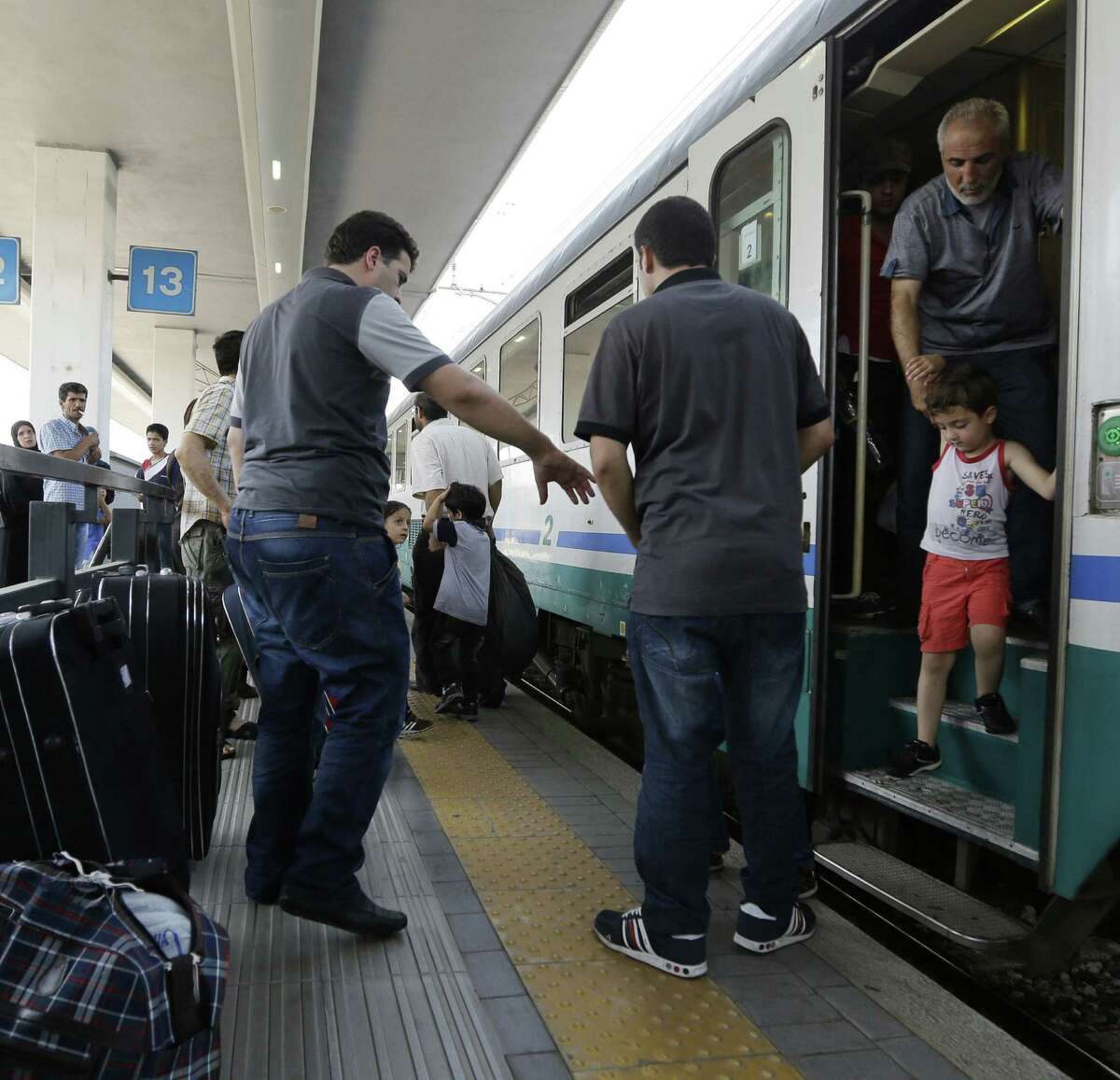 Syrian refugees arrive in Milan.