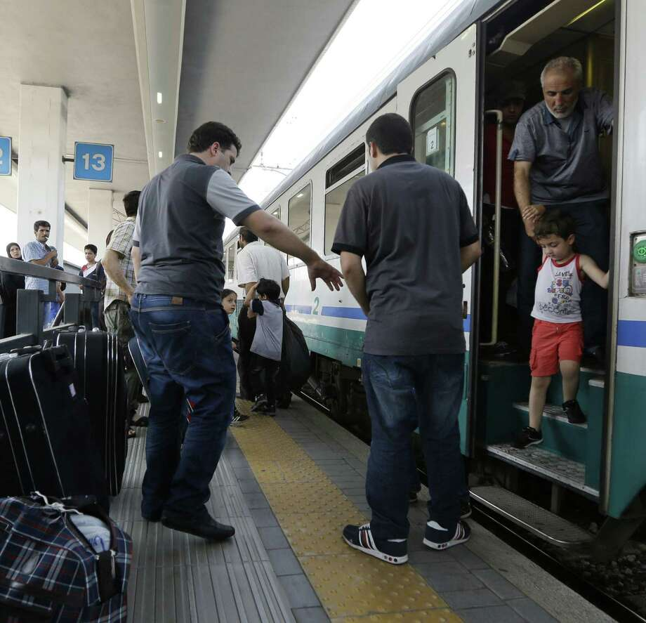 """Syrian refugees arrive in Milan. """"No Syrian wants to get fingerprinted,"""" says one traveler passing through the city. Photo: Luca Bruno / Associated Press / AP"""