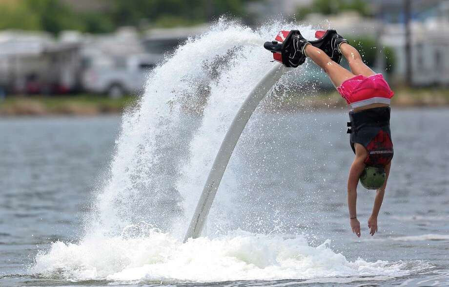 Brittany Coolidge from Ocean Springs, Miss. Flyboard  in the Ouffats Bayou in Galveston. This was Collidge birthday present from her parents who live in Houston. A Flyboard is a type of water jetpack attached to a personal water craft which supplies propulsion to drive the Flyboard through air and water to perform a sport known as flyboarding. Photo: Thomas B. Shea, For The Chronicle / © 2014 Thomas B. Shea