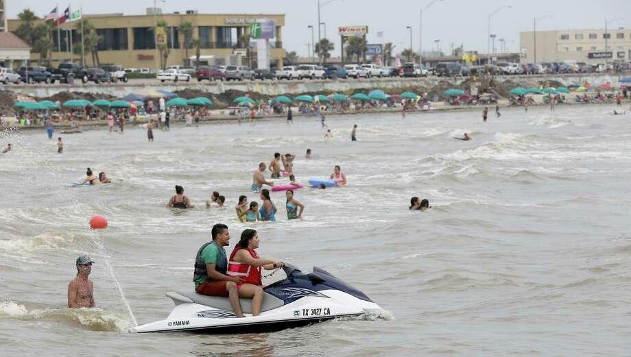 Despite the sargassum Galveston Beach had plenty of activity on July 5, 2014. Photo: Thomas B. Shea, For The Chronicle / © 2014 Thomas B. Shea