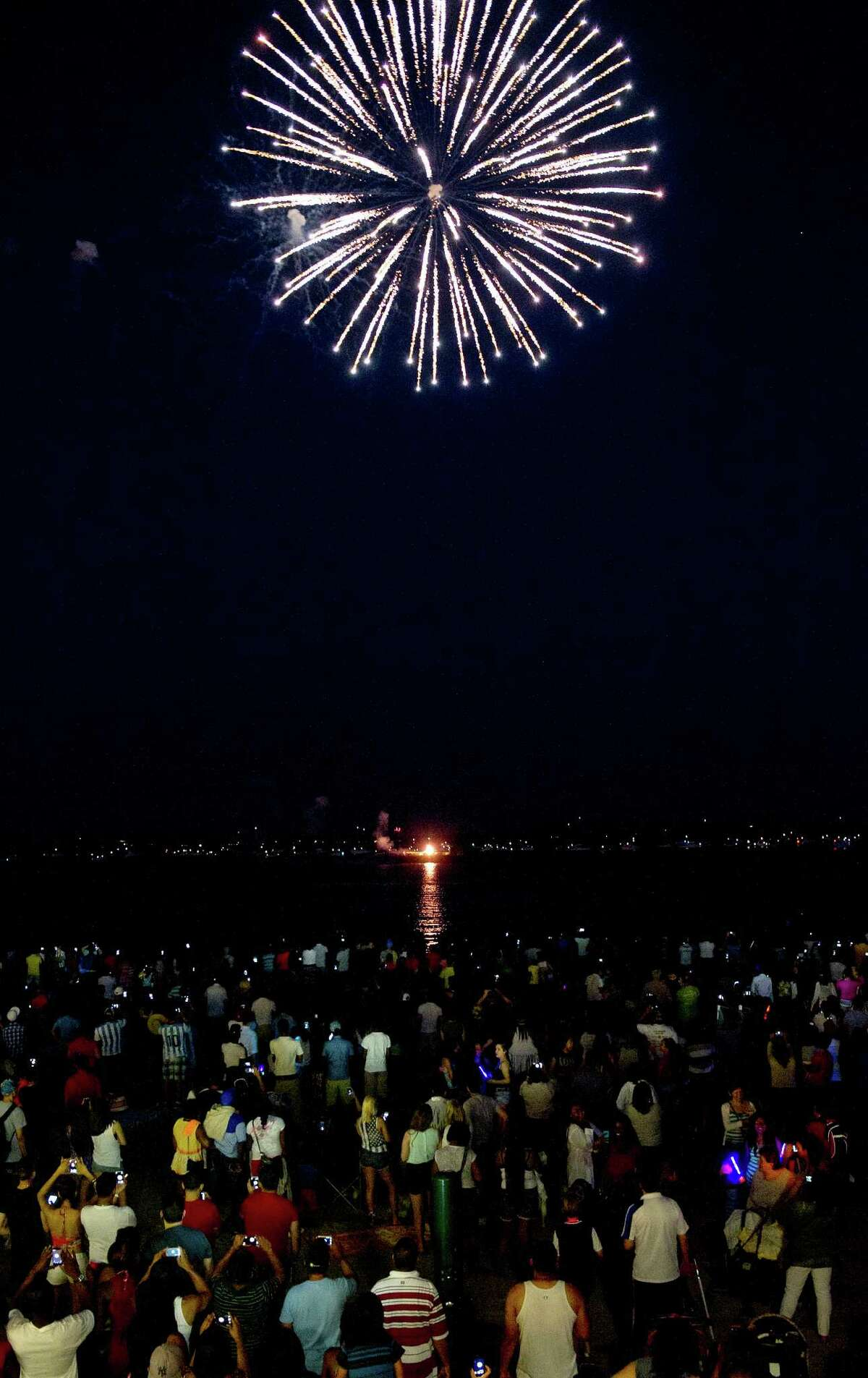Fireworks light up the sky over Cummings Beach in Stamford, Conn., on Saturday, July 5, 2014.