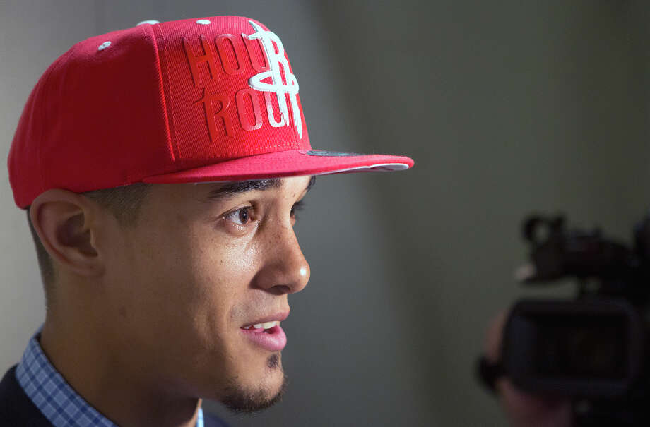 Rockets rookie guard Nick Johnson has good basketball genetics on his side as he tries to rise above his perceived slight as a second-round draft pick. Photo: Cody Duty, Staff / © 2014 Houston Chronicle