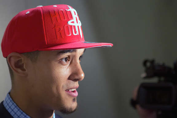Rockets rookie guard Nick Johnson has good basketball genetics on his side as he tries to rise above his perceived slight as a second-round draft pick.
