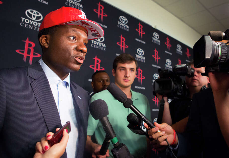Clint Capela, left, has come a long way in a short time to be a first-round pick of the Rockets. Literally. After growing up in Switzerland and then developing his basketball skills in France, the 20-year-old Capela said the NBA wasn't even on his radar until recently. Photo: Cody Duty, Staff / © 2014 Houston Chronicle
