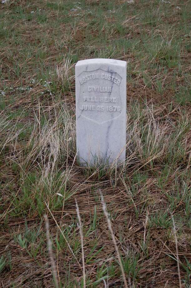 A marble headstone marks where a member of the 7th Calvary fell during battle in 1876. Photo: Richard A. Marini / San Antonio Express-News