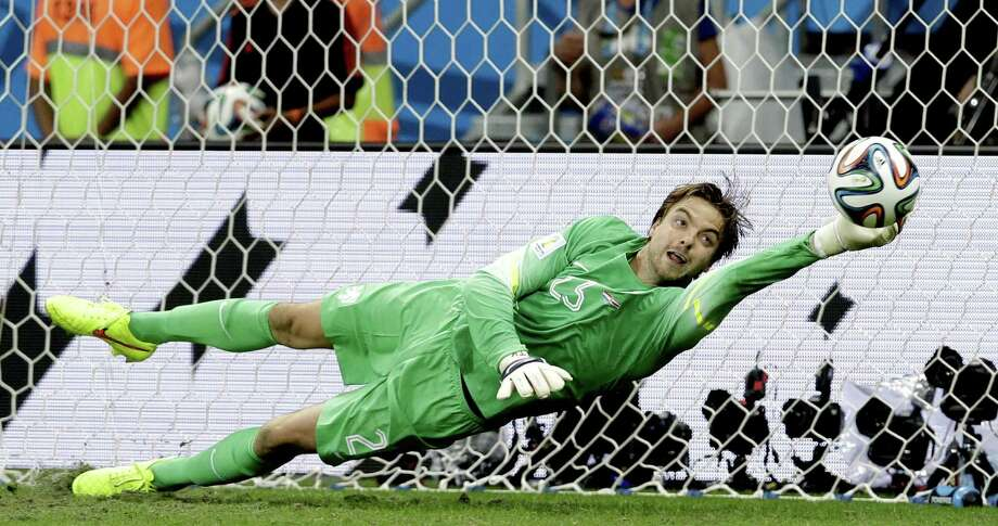 Netherlands goalkeeper Tim Krul, who entered the match in the final minute of extra time, makes one of his two shootout saves. Photo: Hassan Ammar / Associated Press / AP