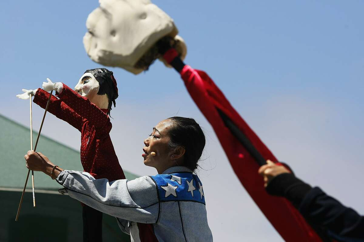 Keiko Carreiro performs of the San Francisco Mime Troupe performs at Dolores Park in San Francisco, Calif. on Friday, July 4, 2014. The four-person troupe will put on a show called