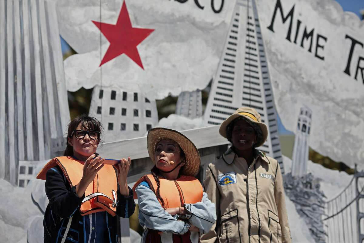 Left to right, Lisa Hori-Garcia, Keiko Carreiro and Velina Brown of the San Francisco Mime Troupe perform at Dolores Park in San Francisco, Calif. on Friday, July 4, 2014. The four-person troupe will put on a show called