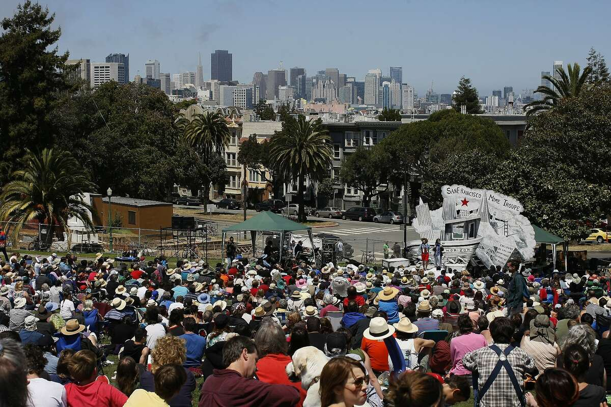 The San Francisco Mime Troupe performs at Dolores Park in San Francisco, Calif. on Friday, July 4, 2014. The four-person troupe will put on a show called