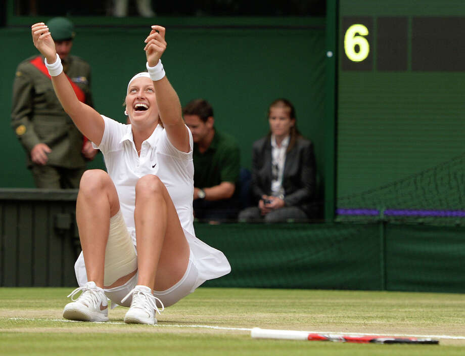 As a 6-3, 6-0 winner, Petra Kvitova celebrates the most dominating women's final at Wimbledon since Steffi Graf lost only three games to Monica Seles in 1992. Photo: Anthony Devlin, SUB / PA