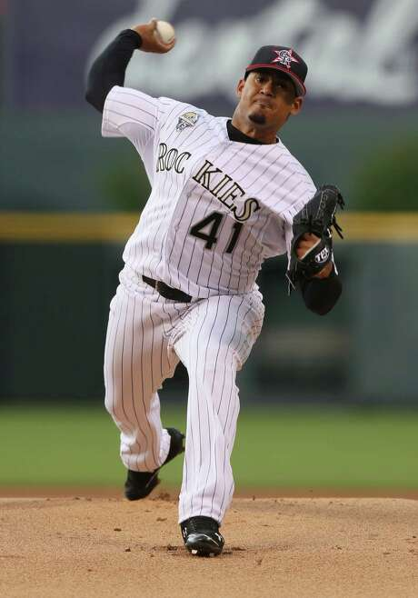 Making his season debut, Colorado Rockies starting pitcher Jair Jurrjens works against the Los Angeles Dodgers in the first inning of a baseball game in Denver, Friday, July 4, 2014. (AP Photo/David Zalubowski) Photo: David Zalubowski, STF / AP