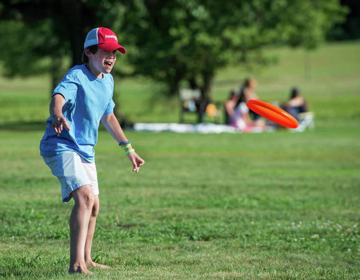 Ryan Banico plays frisbee at the annual Family Fourth event held at Waveny Park, New Canaan, CT on Saturday, July 5th, 2014.