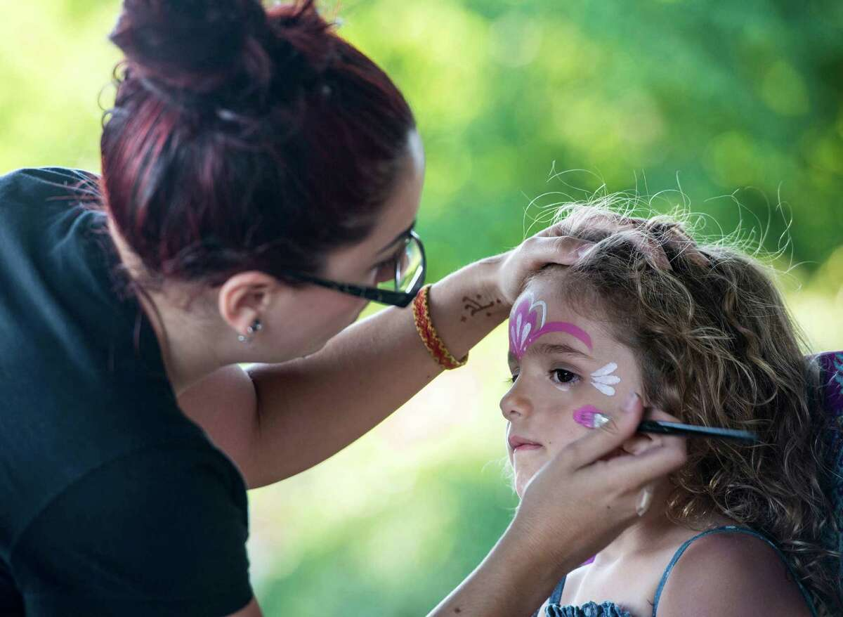 Emily Giskin paints the face of Kathryn Iacono at the annual Family Fourth event held at Waveny Park, New Canaan, CT on Saturday, July 5th, 2014.