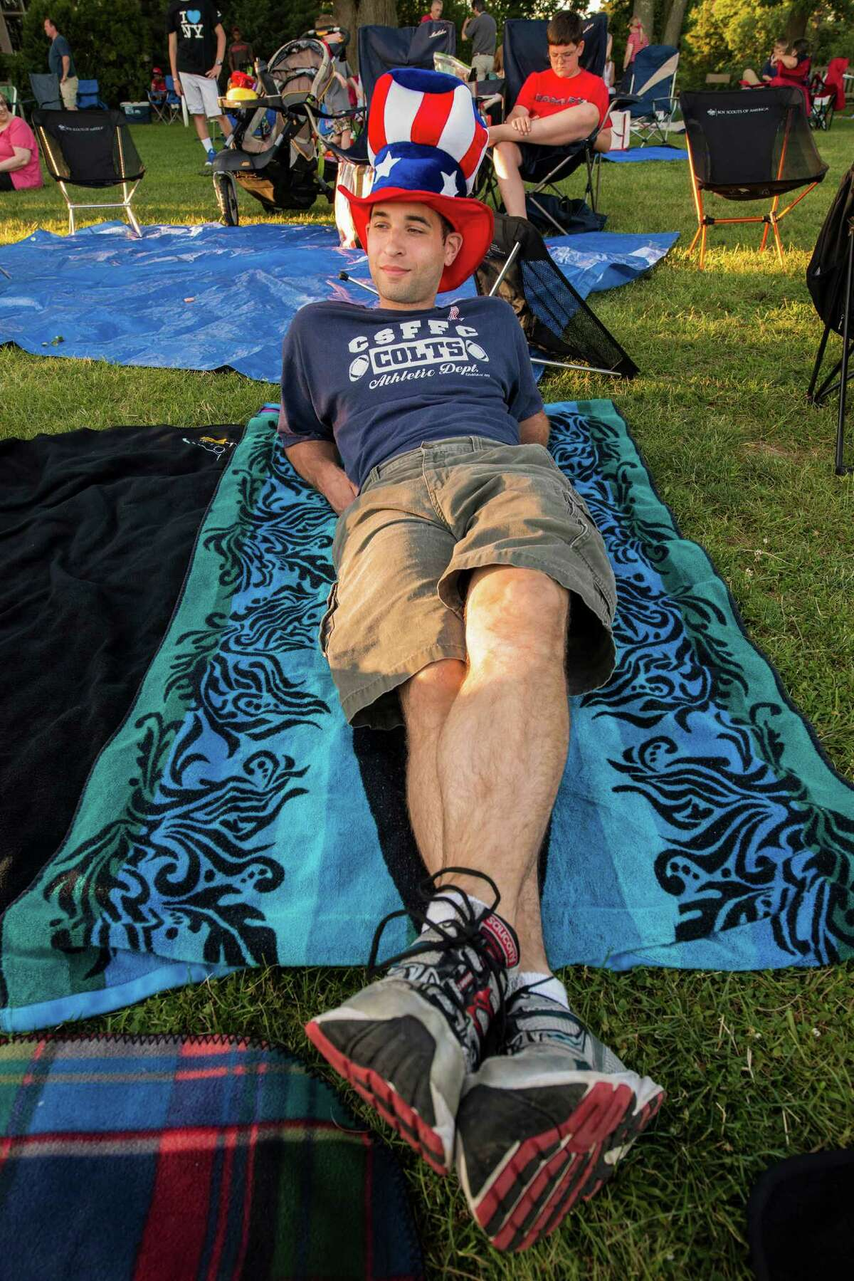 Marcel Nunez waits for the fireworks to start at the annual Family Fourth event held at Waveny Park, New Canaan, CT on Saturday, July 5th, 2014.