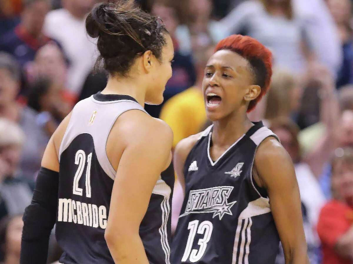 Kayla McBride (left) is congratulated by teammate Danielle Robinson after McBride hit the game-winning 3-pointer with 1.8 seconds left for the Stars. The shot capped a comeback against Indiana, which was up by 13 points with over five minutes to go.