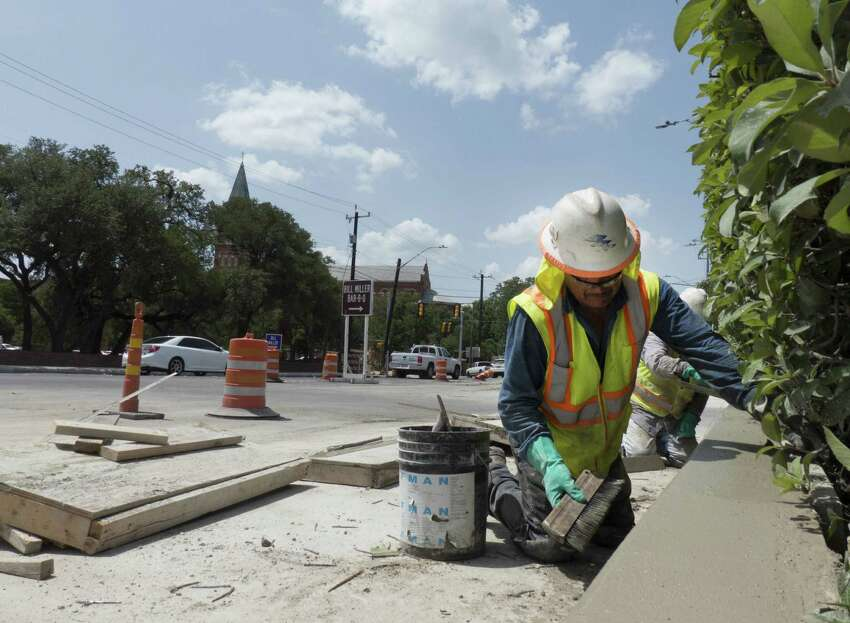 Carlos Torres works on July 3, 2014 on a concrete wall that's part of the project to improve storm drainage and traffic flow on Broadway near the University of the Incarnate Word.