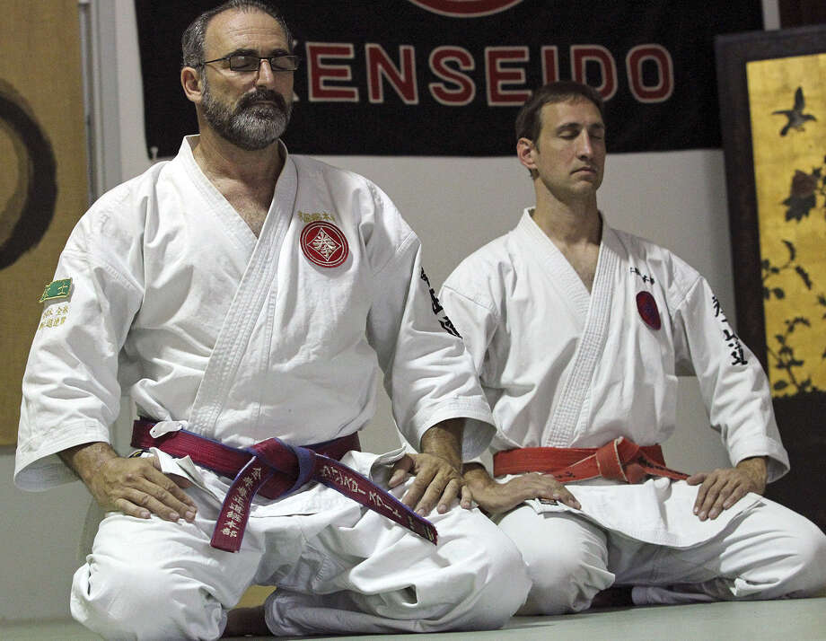 Swart (left), of San Antonio, pauses in the seize position while meditating as he practices kenseido with Von Shields. Photo: Tom Reel / San Antonio Express-News / San Antonio Express-News