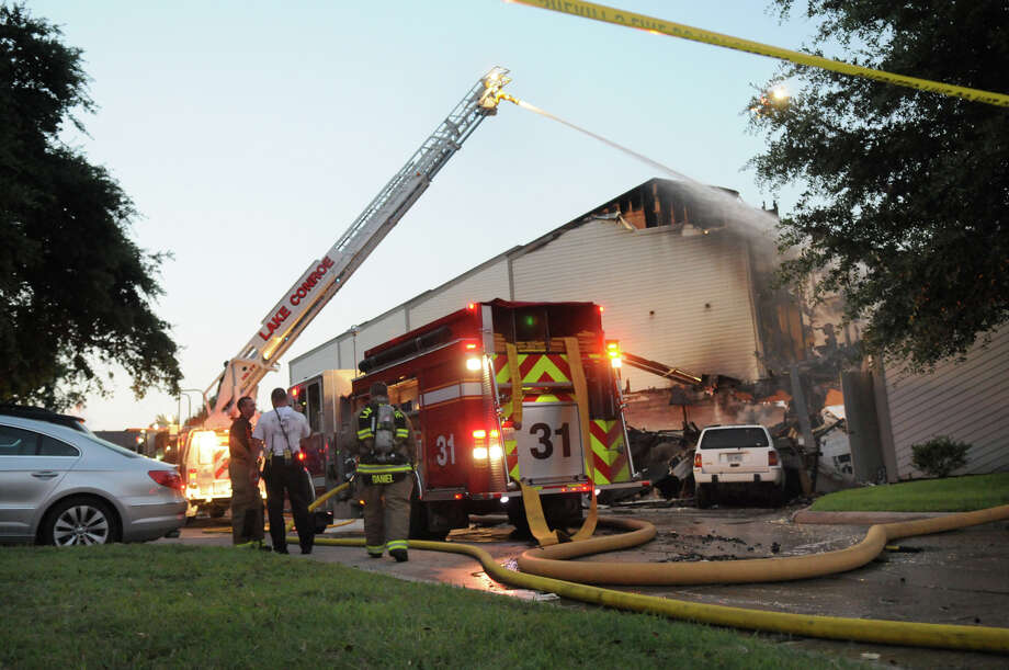 April Sound Condominiums in Conroe was the scene of a four-alarm fire on Saturday. Photo: Jerry Baker, For The Chronicle
