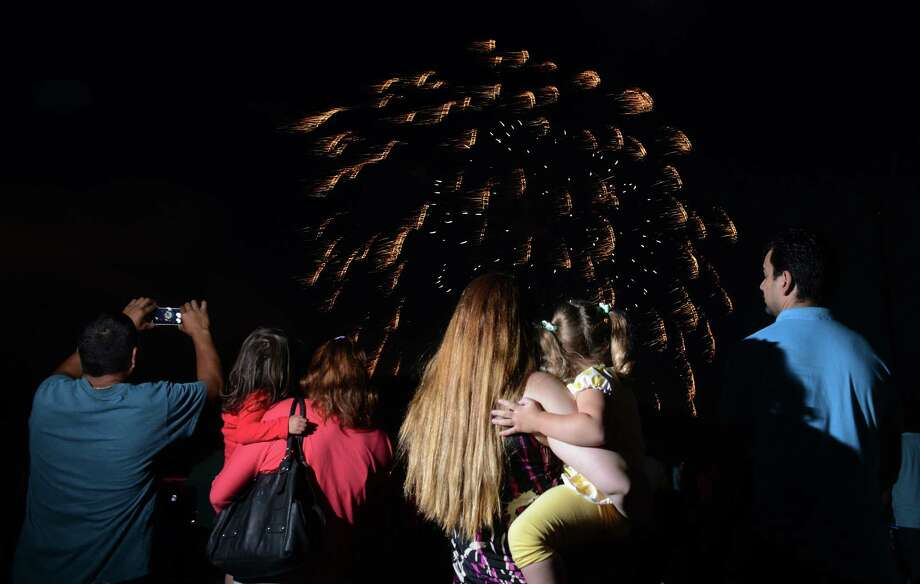 "Photos from the Annual Fireworks Celebration at the Danbury Fair in Danbury, Conn. Saturday, July 5, 2014.  Originally scheduled for July 3, the fireworks celebration featured live music by ""Fast Ricky"" and ""The Zoo"" with kids inflatables and games, topped off by a fireworks show over the mall at 9:30. Photo: Tyler Sizemore / The News-Times"