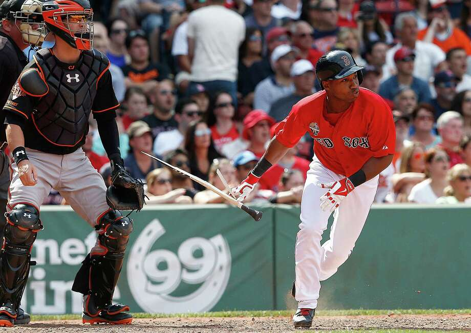 BOSTON, MA - JULY 5: Jonathan Herrera #10 of the Boston Red Sox singles in the winning run in the ninth inning during the first game of a doubleheader at Fenway Park on July 5, 2014 in Boston, Massachusetts.  (Photo by Jim Rogash/Getty Images) ORG XMIT: 477585979 Photo: Jim Rogash / 2014 Getty Images