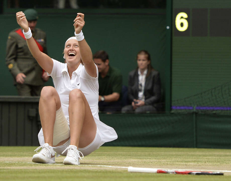 Petra Kvitova exults after defeating Eugenie Bouchard 6-3, 6-0 in 55 minutes to win Wimbledon for the first time since 2011. Photo: Anthony Devlin / Associated Press / PA