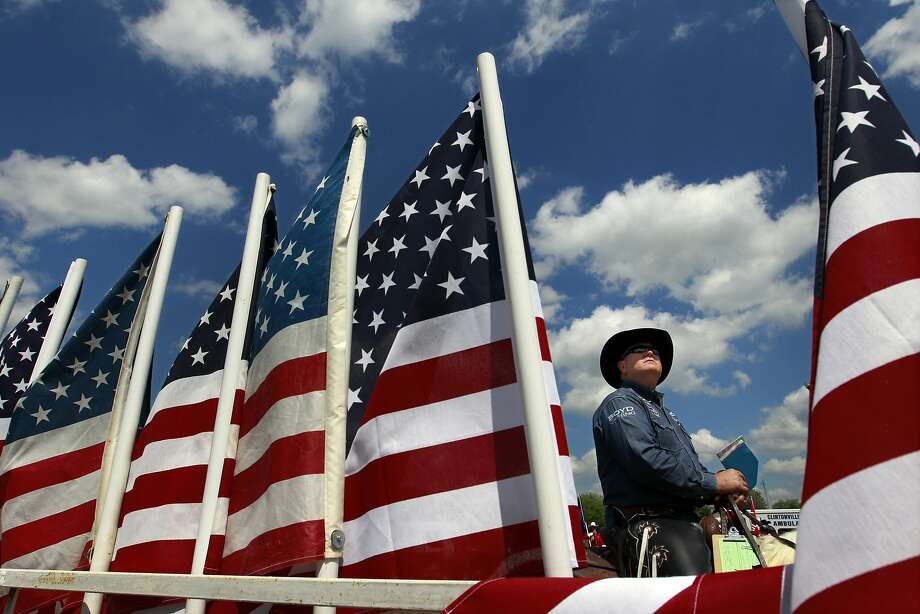 Roger Mooney waits to announce the next event during the Manawa Mid-Western Rodeo in Manawa, Wis. on Saturday, July 5, 2014. (AP Photo/The Post-Crescent, Dan Powers) Photo: Dan Powers, Associated Press