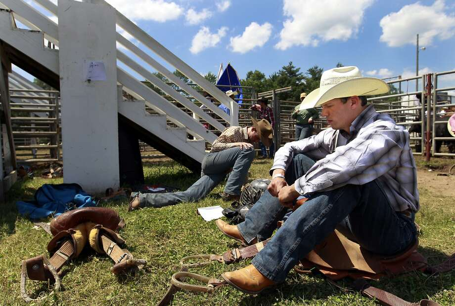 Logan Hullinger of Davis City, Iowa, looks own before his saddle bronc riding event during the Manawa Mid-Western Rodeo on Saturday, July 5, 2014, in Manawa, Wis. (AP Photo/The Post-Crescent, Dan Powers) NO SALES Photo: Dan Powers, Associated Press