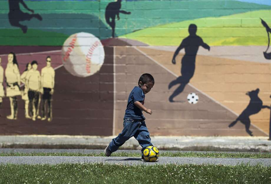 Antonio Ramos kicks the soccer ball during a hot Summer day in Camden, N.J., Saturday, July 5, 2014. (AP Photo/Camden Courier-Post, Jose F. Moreno)  NO SALES Photo: Jose F. Moreno, Associated Press