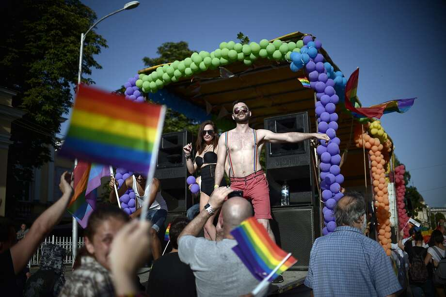 People dance on a truck during the annual Gay Pride parade in central Sofia on July 5, 2014, as people march through the Bulgarian capital to protest discrimination against gays, lesbians and transsexuals and improve their integration in society. AFP PHOTO / NIKOLAY DOYCHINOVNIKOLAY DOYCHINOV/AFP/Getty Images Photo: Nikolay Doychinov, AFP/Getty Images