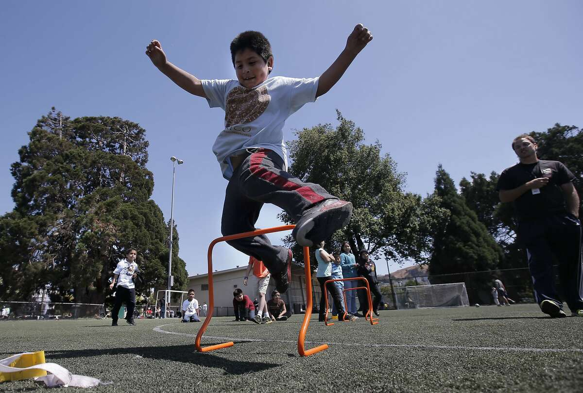 Alexis runs an obstacle course at Garfield Park in San Francisco. City youth programs may be helping to reduce violence.