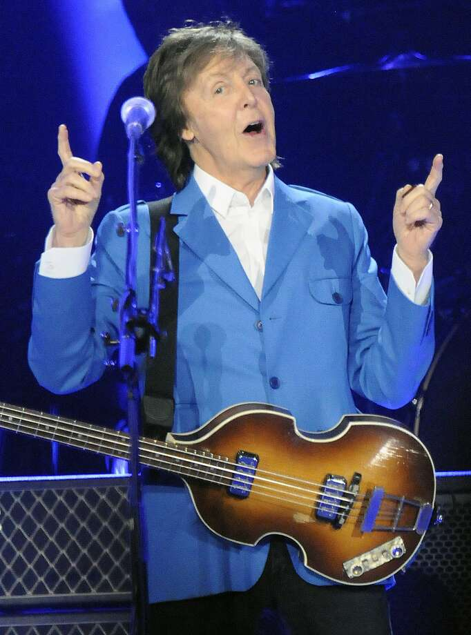 "Sir Paul McCartney performs with his band during the ""Out There"" Tour at the Times Union Center on Saturday, July 5, 2014, in Albany, N.Y. (Photo by Hans Pennink/Invision/AP) Photo: Hans Pennink, Associated Press"